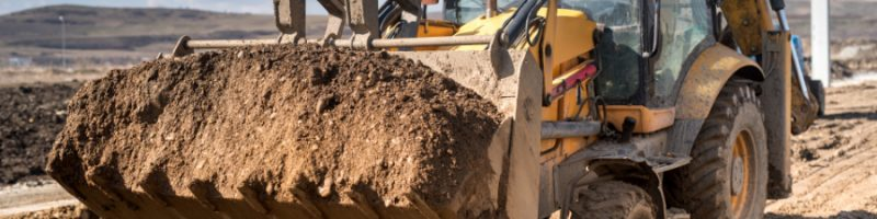 Close up details of industrial backhoe loader, details of machinery on construction site